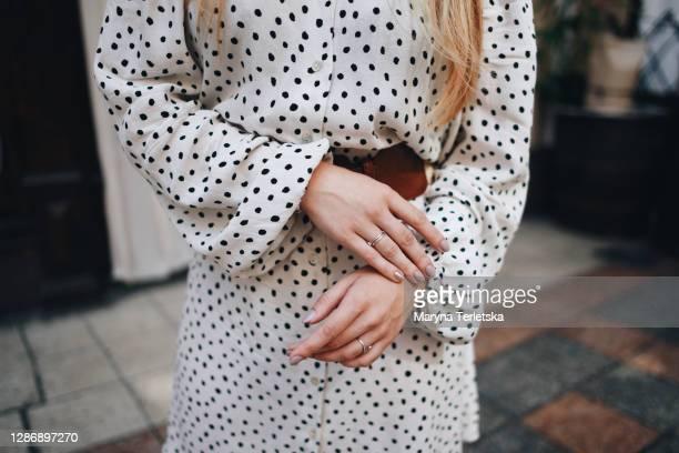 beautiful female hands with well-groomed manicure. - öffentlicher auftritt stock-fotos und bilder