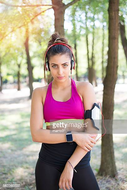 Beautiful female jogger outdoors looking confident