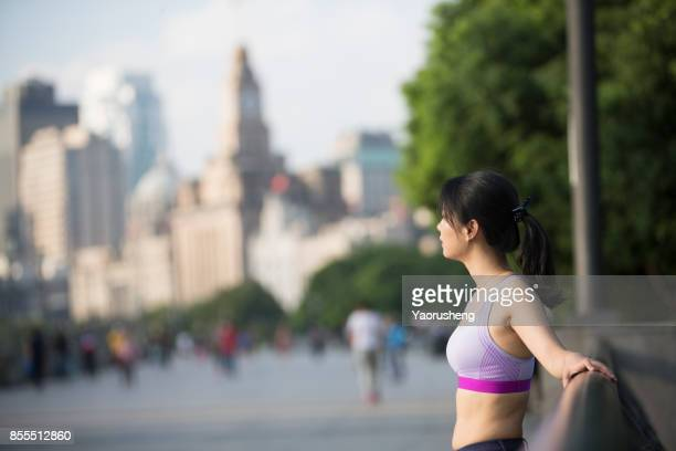 beautiful female joging on the Shanghai bund in the morning