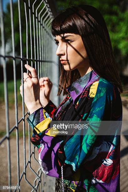 Beautiful female looking through the wire