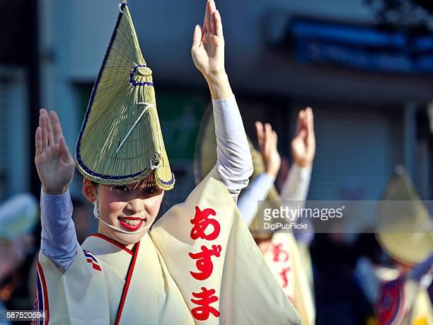 beautiful female participant at kanagawa yamato awaodori smiles at camera - awa dance festival stock photos and pictures