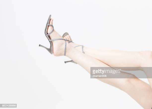 beautiful Female slender and perfect leg with high-heeled shoe with white background