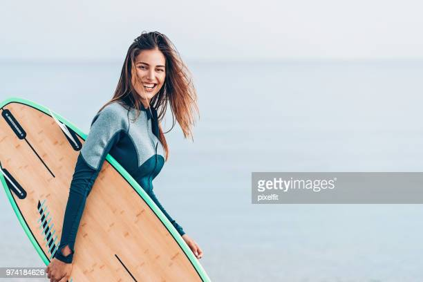 beautiful female surfer, with copy space - surf stock pictures, royalty-free photos & images