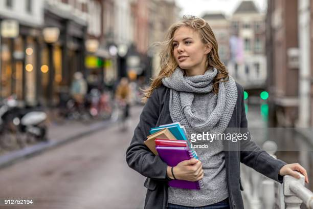 beautiful female university student studying outdoors in delft city centre - dutch culture stock pictures, royalty-free photos & images