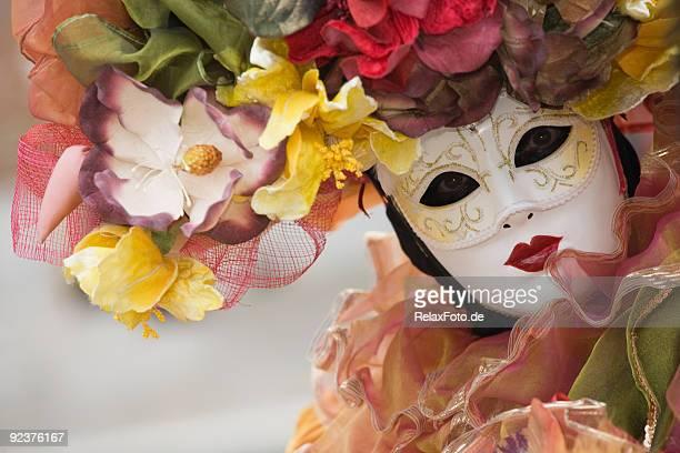Beautiful female venetian mask at carnival in Venice