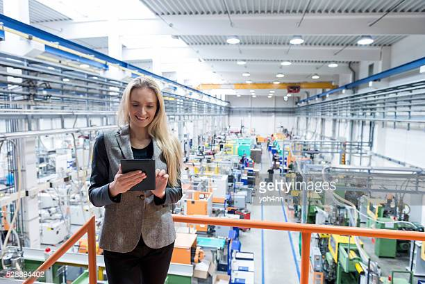 beautiful female worker working on digital tablet - railings stock photos and pictures