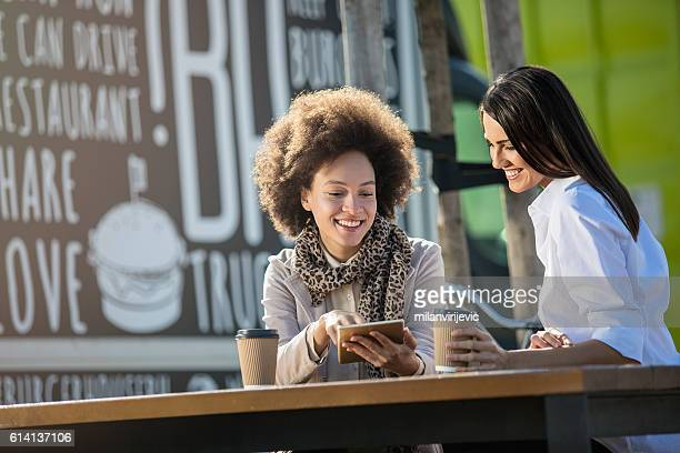 Beautiful females on a coffee break