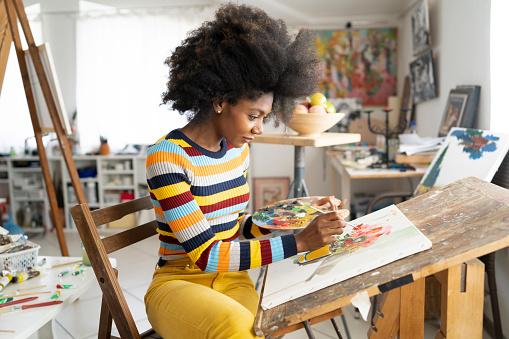 Beautiful fine art painter drawing in studio 1134484969