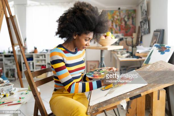 beautiful fine art painter drawing in studio - artist stock pictures, royalty-free photos & images
