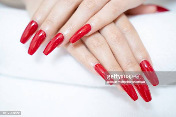 beautiful fingernails painted in red. - stratum corneum stock pictures, royalty-free photos & images