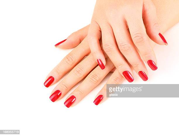beautiful fingernails painted in red. - manicure stock pictures, royalty-free photos & images