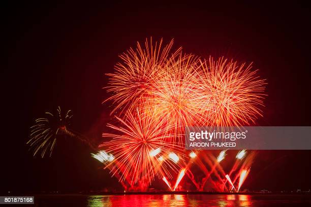 beautiful firework display for celebration over the sea - july stock pictures, royalty-free photos & images