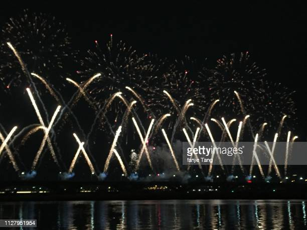 beautiful fireworks on the river - フェス ストックフォトと画像