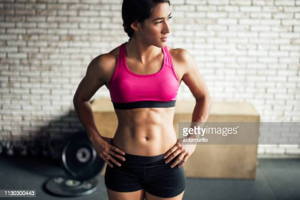 beautiful fit young woman - abdominal muscle stock pictures, royalty-free photos & images
