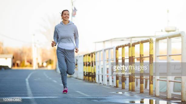 beautiful fitness girl outdoors - tracksuit bottoms stock pictures, royalty-free photos & images