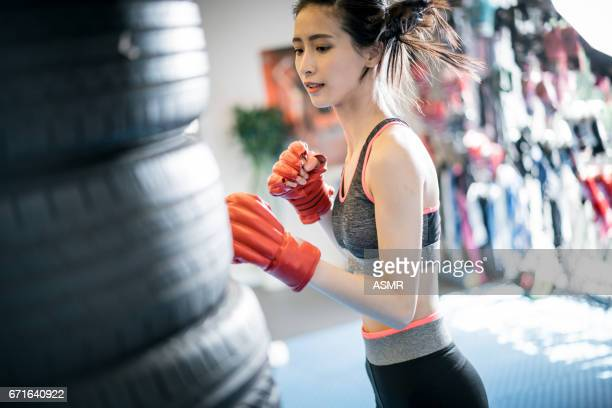 beautiful fitness woman boxing with red gloves - face off sports play stock pictures, royalty-free photos & images