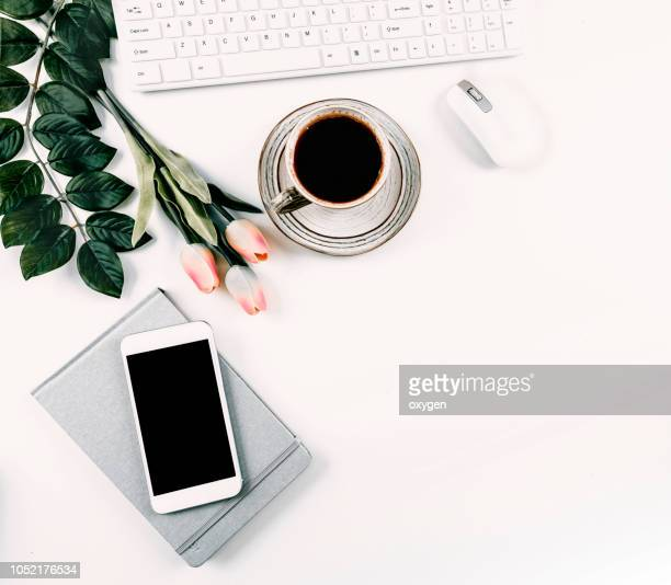 Beautiful flatlay with tulips, cup of coffee, iphone, notebook, feminine flatlay, copyspace
