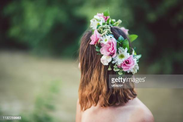 beautiful flowers wreath in the woman hair. - wreath stock pictures, royalty-free photos & images