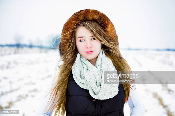 beautiful french canadian teenager in a frozen field winter portrait - canadian culture stock pictures, royalty-free photos & images