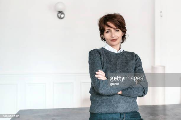 beautiful french woman in appartment - french women stock photos and pictures