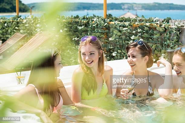 Beautiful Friends Enjoying Together In Hot Tub