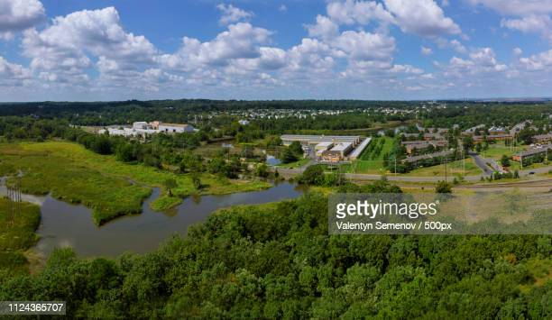 beautiful garden or park with trees, bushes, grass, garden path, pond - {{asset.href}} stock-fotos und bilder