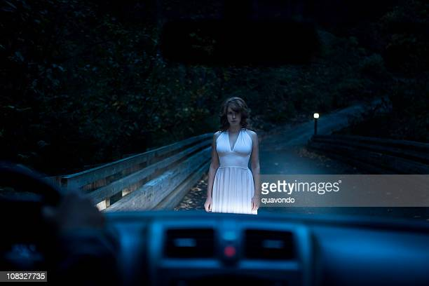 Beautiful Ghostly Woman Standing on Road in Car Headlights