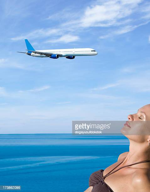 Beautiful girl and flying airplane