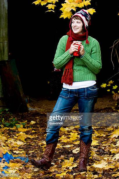 Adorable Young Woman in Scarf and Hat on Fall Day