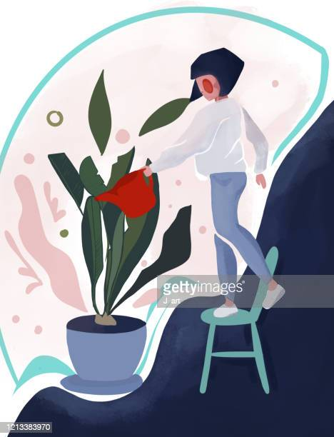 Beautiful girl caring for her plants. Plants growing in pots.