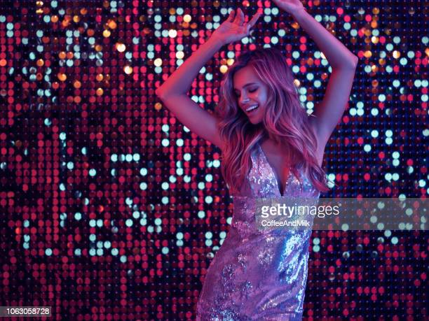 beautiful girl dancing at nightclub - sexy young women stock pictures, royalty-free photos & images