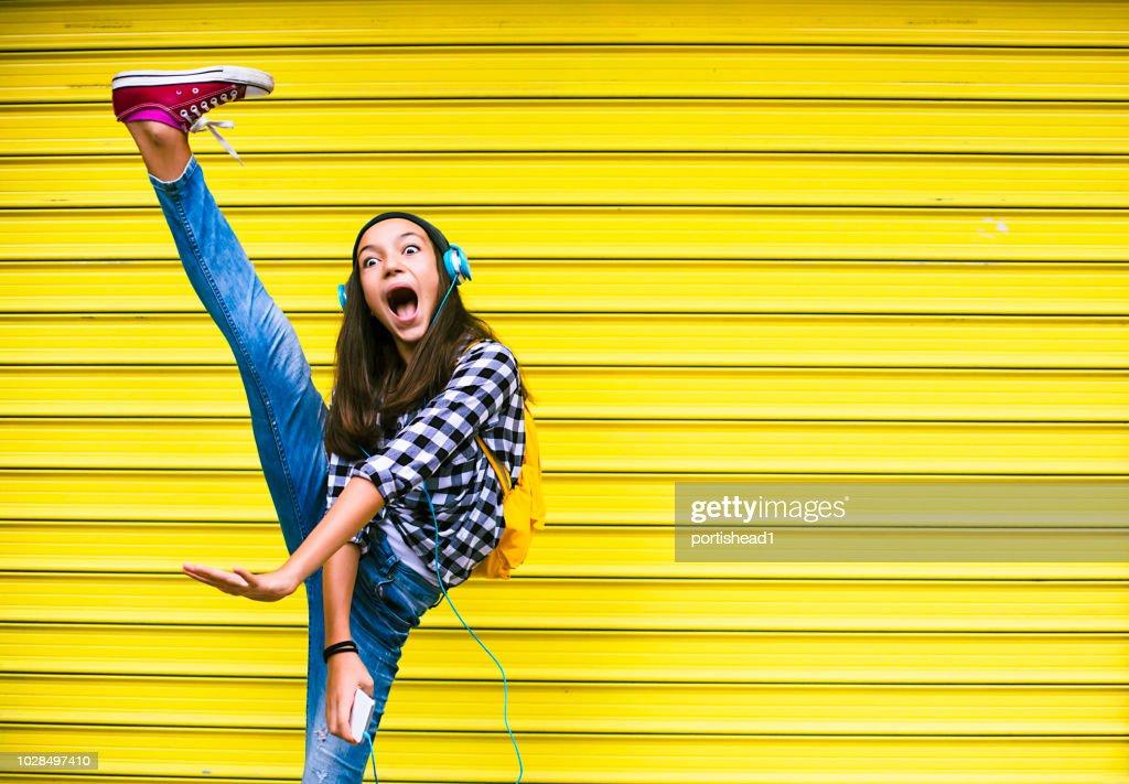 Beautiful girl dancing to the music : Stock Photo