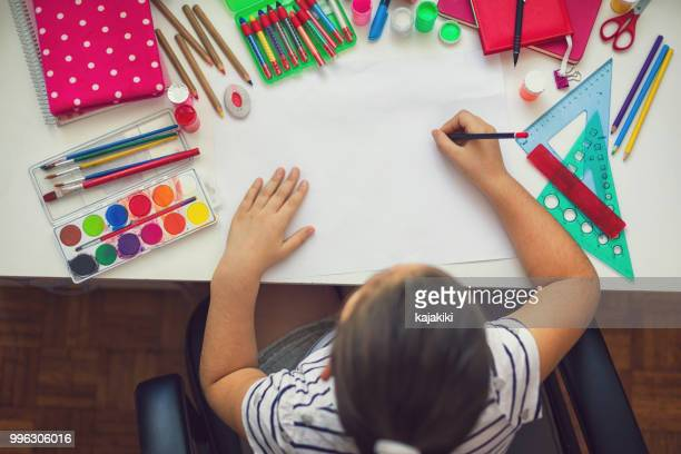 beautiful girl doing homework - school supplies stock pictures, royalty-free photos & images