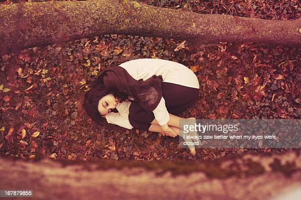 Beautiful girl dreaming in a autumnal wood