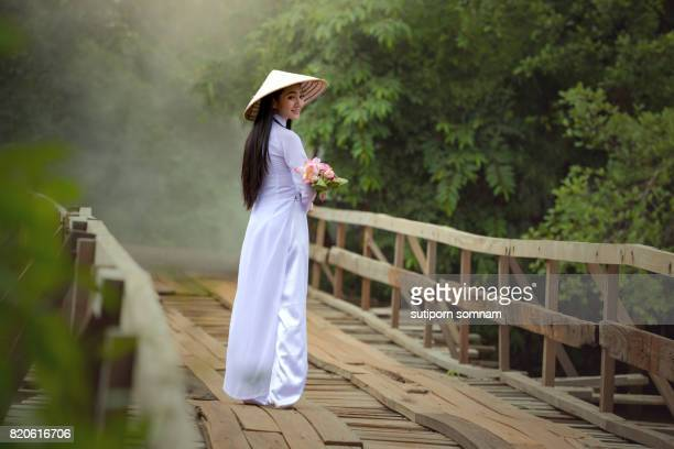 beautiful girl dressed in ao dai traditional costumes of vietnam. - traditionally vietnamese stock pictures, royalty-free photos & images