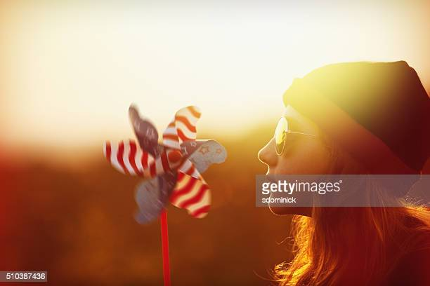 Beautiful Girl During Sunset With Pinwheel