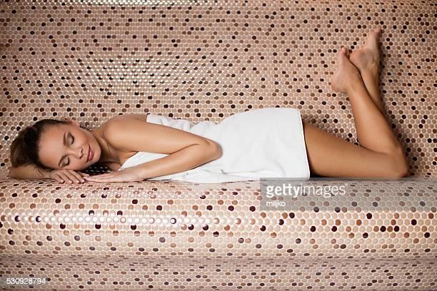 Beautiful girl enjoying in the steam bathroom or sauna
