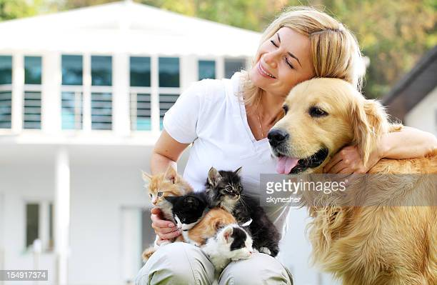 beautiful girl enjoying outdoor with pets. - dog and cat stock photos and pictures