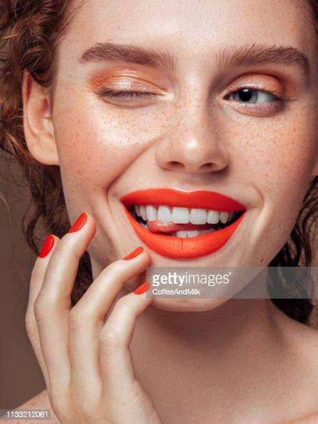 beautiful girl flirts - lipstick stock pictures, royalty-free photos & images