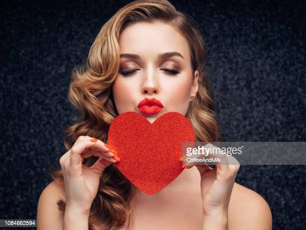 beautiful girl holding artificial heart - valentines day stock pictures, royalty-free photos & images