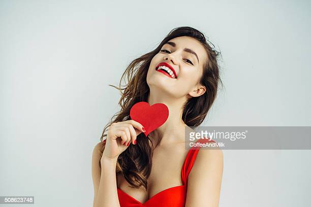 beautiful girl holding artificial heart - valentine card stock photos and pictures