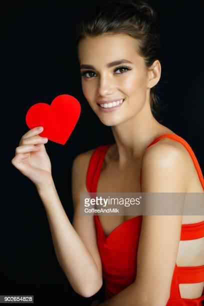 Beautiful girl holding artificial heart
