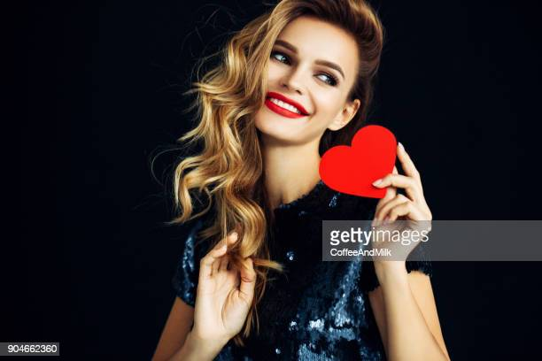 beautiful girl holding artificial heart - hair love stock pictures, royalty-free photos & images