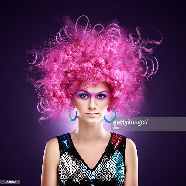 Beautiful girl in a fancy dress and funny pink wig
