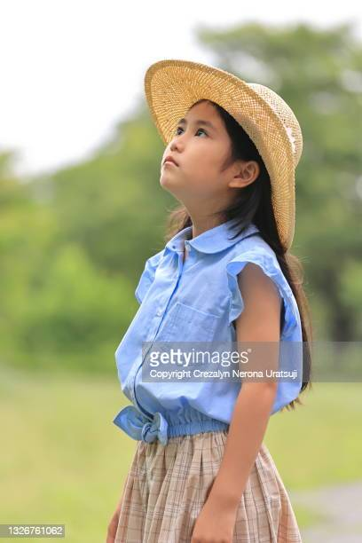 beautiful girl in a summer outfit with straw hat sideview profile portrait - saitama prefecture stock pictures, royalty-free photos & images