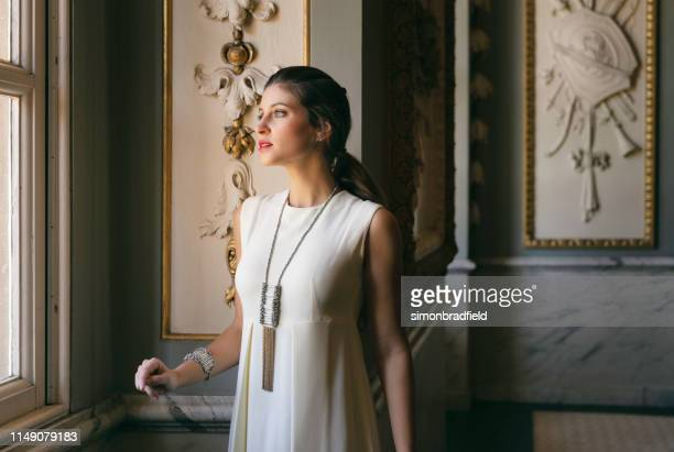 beautiful girl in an english stately home - high society stock pictures, royalty-free photos & images