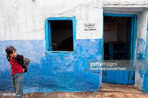 CONTENT] Beautiful girl in front of a traditional bread oven Larache medina Morocco 2013