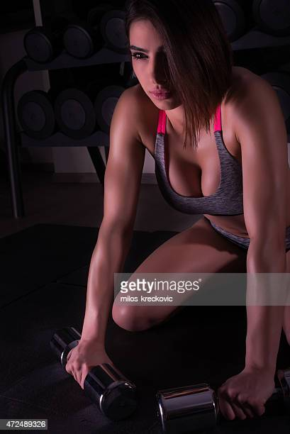 beautiful girl in the gym - cleavage stock pictures, royalty-free photos & images