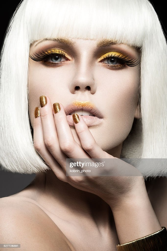 Beautiful Girl In White Wig With Gold Makeup And Nails Stock Photo ...