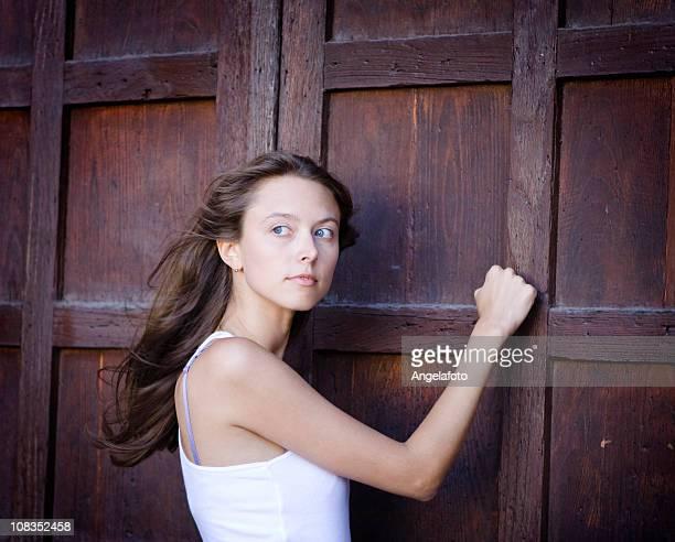 Beautiful Girl Knocking On a Door